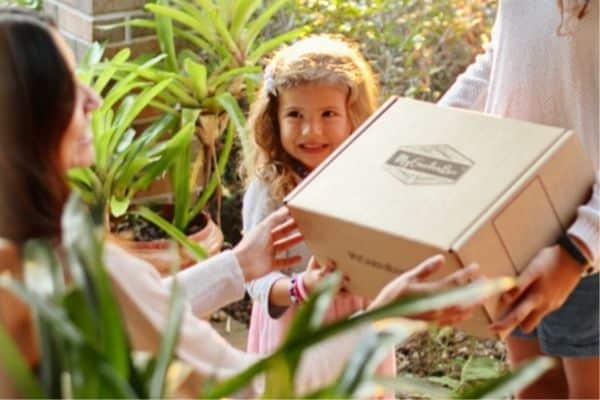 Gift Box Being Given Child Smiling
