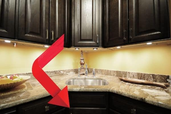 Arrow Pointing To Under Sink For Leaks