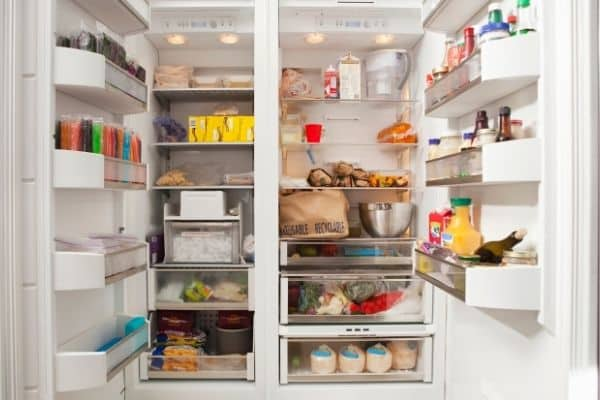 Open refrigerator showing inside of freezer and refrigerator sides