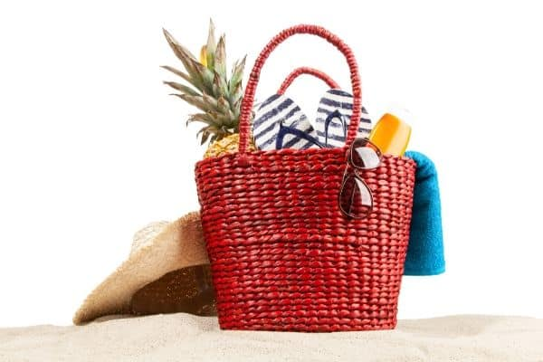 basket with sunscreen shades flipflops