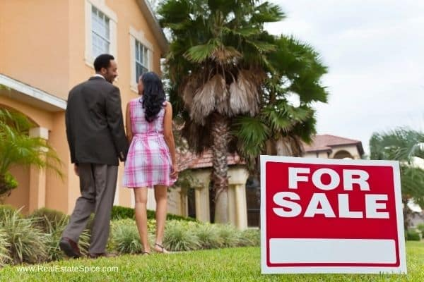 buyers walking up to a home for sale