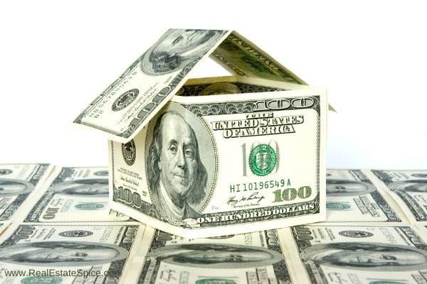 house made of 100 dollar bills sitting on hundred dollar bills
