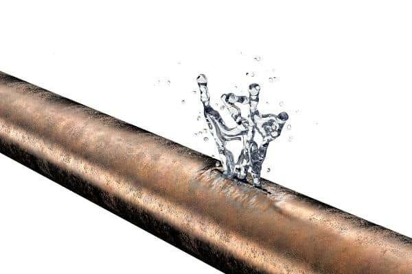 pipe with water bursting through it