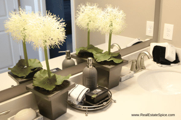 staged bathroom countertop with fancy soaps and hand towels