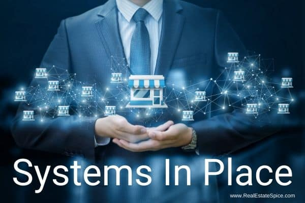 Successful man holding a network of systems